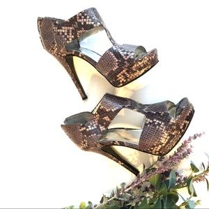 "Nine West t-strap stilettos; ""snakeskin"" pattern"